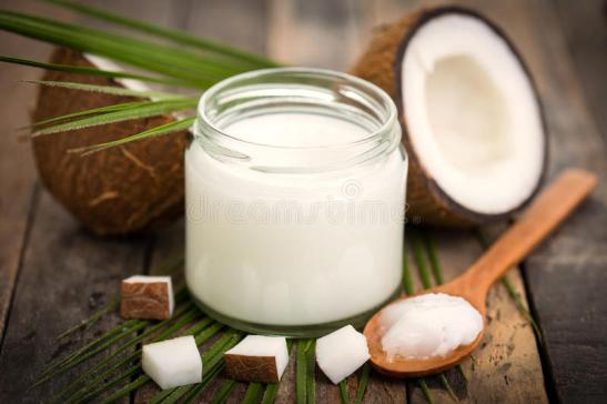 coconut-oil-wooden-table-84360102